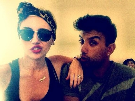 Miley Cyrus in Ray Ban sunglasses
